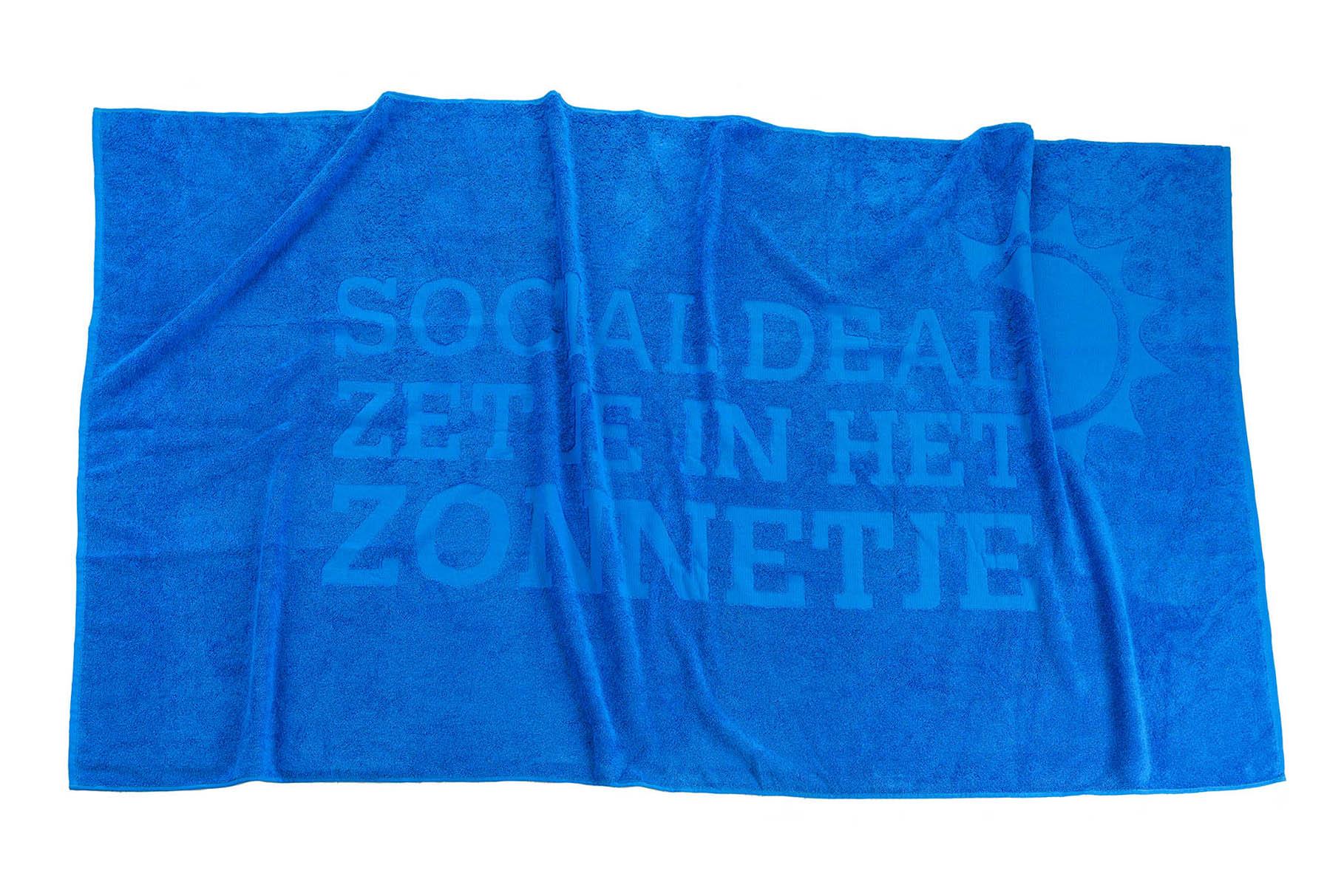 Relief strandlaken socialdeal crop